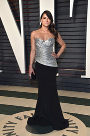 Michelle Rodriguez kept it timeless in a strapless silver and black gown by Christian Siriano at the Vanity Fair Oscar party.