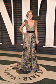 Elizabeth Banks stunned in an embellished Elie Saab Couture gown with a plunging neckline and a partially sheer skirt at the Vanity Fair Oscar party.