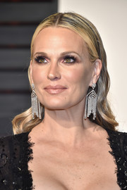 Molly Sims attended the Vanity Fair Oscar party wearing a glamorous 'do that was slicked down at the top and wavy down the ends.