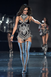 Alessandra Ambrosio looked sultry and glam in a bedazzled bodysuit while walking the Victoria's Secret fashion show.