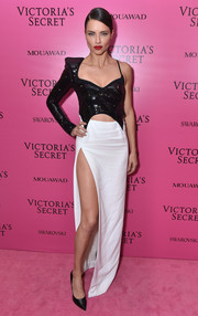 Adriana Lima went for modern glamour in an asymmetrical cutout combo gown by Mugler at the 2017 Victoria's Secret fashion show after-party.