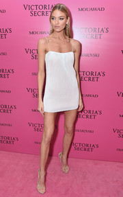 Martha Hunt styled her dress with the iconic Stuart Weitzman Nudist sandals.