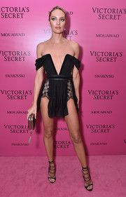 Candice Swanepoel completed her ultra-sexy look with a pair of black lace-up heels.