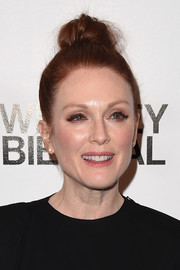 Julianne Moore looked youthful and edgy with her top knot at the 2017 Whitney Biennial.