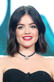 Lucy Hale brightened up her smile with some rich red lipstick.