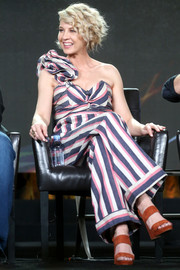 Jenna Elfman looked summery in a striped one-shoulder jumpsuit by Johanna Ortiz at the 2017 Winter TCA Tour.