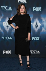 Emily Deschanel accessorized with a studded gold clutch for a bit of shine to her look.