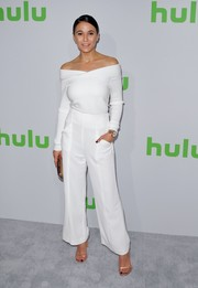 Going all white, Emmanuelle Chriqui paired her top with wide-leg pants.