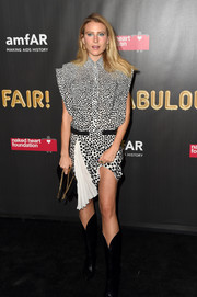 Dree Hemingway went edgy in a spotted Givenchy mini dress and black boots at the 2017 amfAR Fabulous Fund Fair.