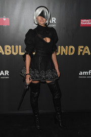 We're not sure what Jessica Hart came dressed as at the 2017 amfAR Fabulous Fund Fair, but she sure looked cute in this black cutout mini dress with white trim!