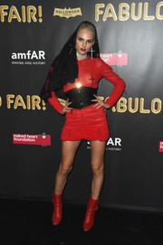 Andreja Pejic vamped it up in a semi-sheer, ruched red mini dress at the 2017 amfAR Fabulous Fund Fair.