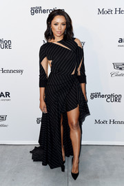 Kat Graham was ultra modern in a deconstructed-chic pinstriped cutout dress by Valentin Yudashkin at the 2017 amfAR generationCURE party.