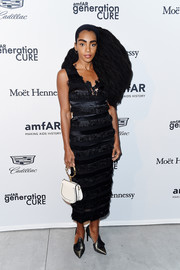 Cipriana Quann channeled her inner flapper girl in a Julianna Bass LBD with layers of fringe for the 2017 amfAR generationCURE party.