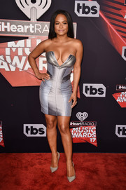 Christina Milian paired her sexy frock with simple gray pumps.