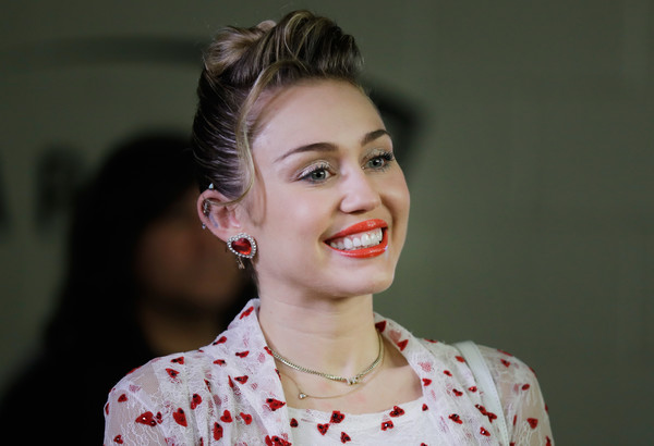 More Pics of Miley Cyrus Statement Ring (1 of 18) - Miley Cyrus Lookbook - StyleBistro [hair,face,facial expression,lip,eyebrow,hairstyle,skin,beauty,lady,smile,miley cyrus,backstage,las vegas,nevada,t-mobile arena,iheartradio music festival]