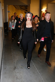 Black peep-toe booties completed Demi Lovato's outfit.