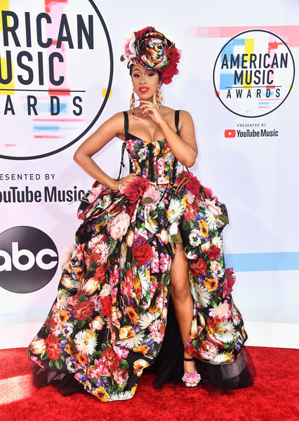 Cardi B went for a showstopping floral corset ball gown by Dolce & Gabbana at the 2018 American Music Awards.