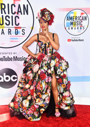Cardi B matched her dress with a pair of floral platform sandals.