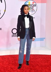 Amandla Stenberg was masculine-chic in a black tux jacket by Ralph Lauren at the 2018 American Music Awards.