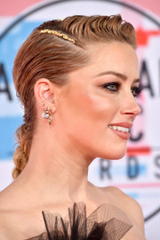 Amber Heard styled her hair into an edgy braid for the 2018 American Music Awards.