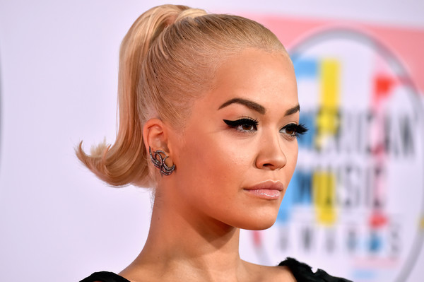 Rita Ora amped up the retro vibe with a thick cat eye.