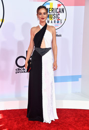 Leighton Meester looked sassy in a black-and-white crossover halter gown by Sonia Rykiel at the 2018 American Music Awards.