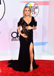 Carrie Underwood showed off her sophisticated maternity style in an embellished black cold-shoulder gown by Steven Khalil at the 2018 American Music Awards.