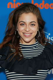 Baby Ariel added a bit of sparkle with a pair of diamond hoops.