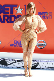 Tyra Banks wrapped up her curves in an embroidered nude jumpsuit by Stello for the 2018 BET Awards.
