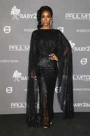 Kelly Rowland looked regal in a sequined cape-sleeve gown by Krikor Jabotian at the 2018 Baby2Baby Gala.