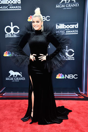 Bebe Rexha chose an eye-catching black Christian Siriano fishtail gown with ruffled shoulders and sleeves for the 2018 Billboard Music Awards.
