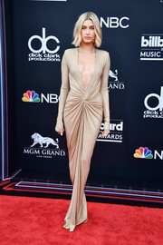 Hailey Baldwin looked seductive in a plunging nude gown by Alexandre Vauthier at the 2018 Billboard Music Awards.