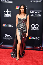 Padma Lakshmi looked ravishing in a slinky silver one-shoulder gown by The Blonds at the 2018 Billboard Music Awards.