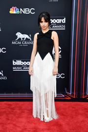 Camila Cabello went for a playful look in a black-and-white Givenchy gown with a bowed neckline and a fringed skirt at the 2018 Billboard Music Awards.