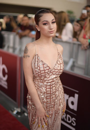 Bhad Bhabie added a 'Family First' tattoo below the flower.