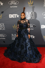 Janet Jackson stunned in a navy Christian Siriano ball gown with velvet flower accents at the 2018 Black Girls Rock! event.