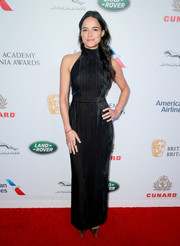 Michelle Rodriguez cut a shapely figure in this black Ulyana Sergeenko halter gown at the 2018 British Academy Britannia Awards.
