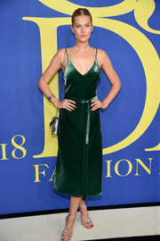 Toni Garrn went for a simple yet chic green satin slip dress by Frame when she attended the 2018 CFDA Fashion Awards.