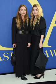 Mary-Kate Olsen bundled up in an ankle-length black tuxedo dress by The Row for the 2018 CFDA Fashion Awards.