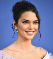 Kendall Jenner pulled her locks back into a messy updo for the 2018 CFDA Fashion Awards.