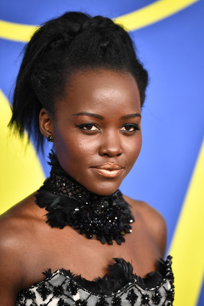 Lupita Nyong'o styled her hair into a braided updo for the 2018 CFDA Fashion Awards.
