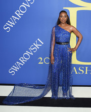 Issa Rae wowed in an electric-blue Pyer Moss jumpsuit with a sparkly overlay and a long train at the 2018 CFDA Fashion Awards.