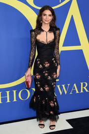 Emily Ratajkowski coordinated her dress with an antique-rose velvet clutch by Hunting Season.