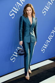 Diane Lane polished off her look with a navy satin purse, also by Gabriela Hearst.
