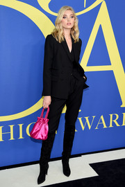 For a pop of color, Elsa Hosk accessorized with a hot-pink satin pouch.