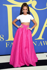 Joan Smalls kept it casual and sexy in a white crop-top by Brandon Maxwell at the 2018 CFDA Fashion Awards.