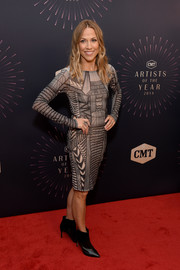 Sheryl Crow attended the 2018 CMT Artists of the Year event wearing a geometric-patterned sheath dress.