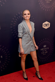 Danielle Bradbery teamed her dress with a funky pair of black mesh booties by Schutz.