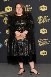 Chrissy Metz paired her dress with a cute wooden box clutch.