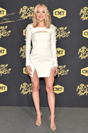 Danielle Bradbery completed her outfit with a pair of silver ankle-strap sandals.
